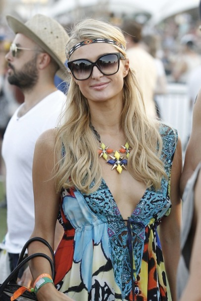 Paris Hilton is seen attending Coachella Valley Music and Arts Festival wearing a blue print dress in Indio